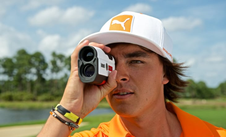 Golfer using rangefinder