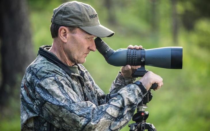 Man adjusting spotting scope