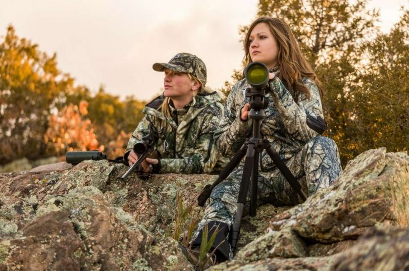 Women using rangefinder to hunt