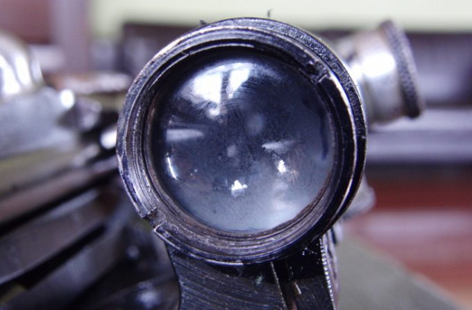 Worn out rifle scope lens