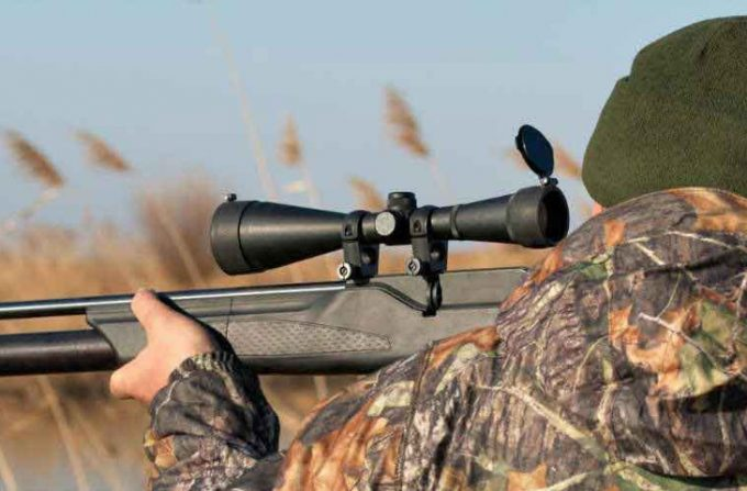 Hunter looking through scope