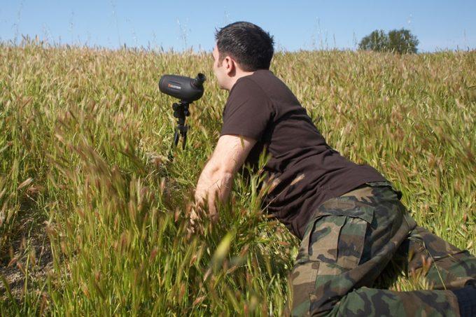 Man using mini spotting scope