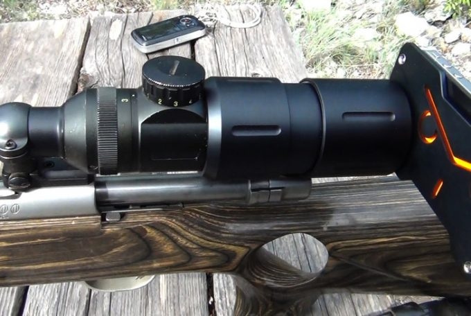 Scope with cam on rifle