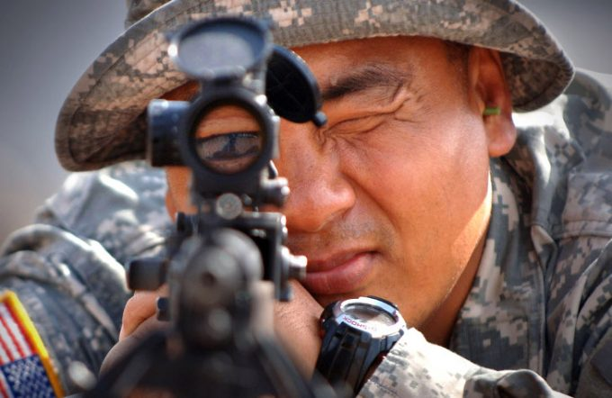 Soldier testing rifle scope alignment