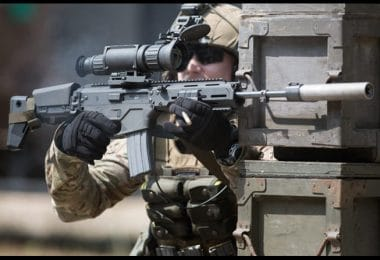 Soldier using thermal scoped gun