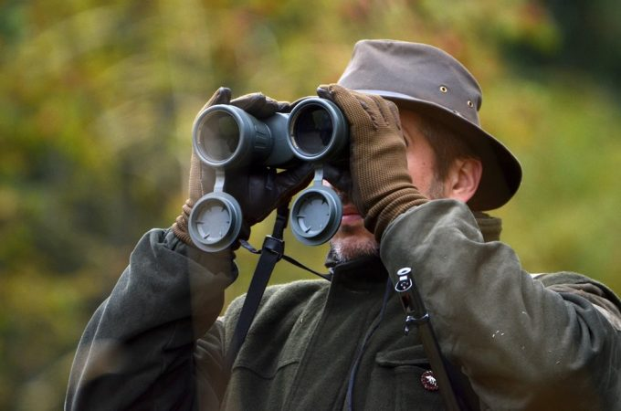 Hunter using binoculars
