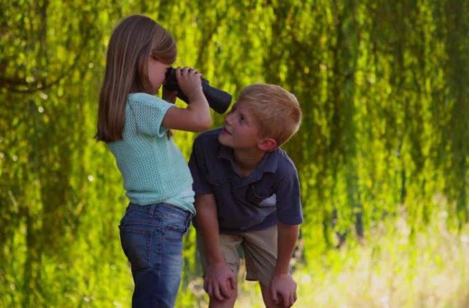 Kids play with binoculars