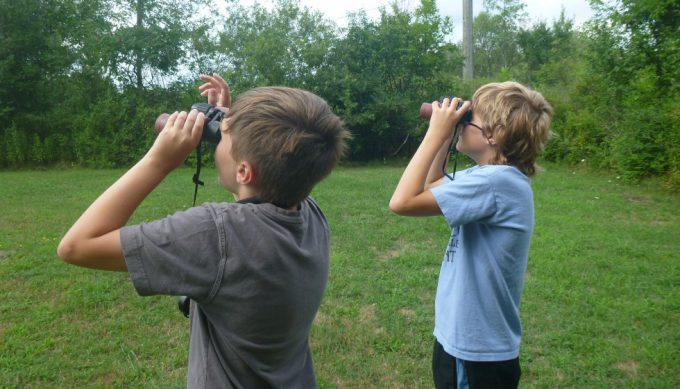 Kids using binoculars for birding