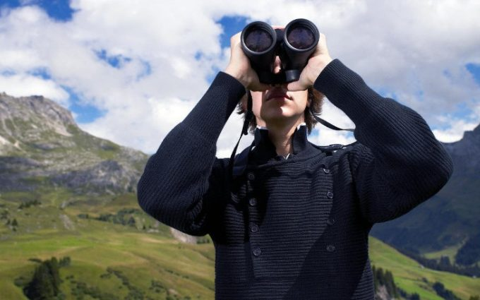 Looking at view using binoculars