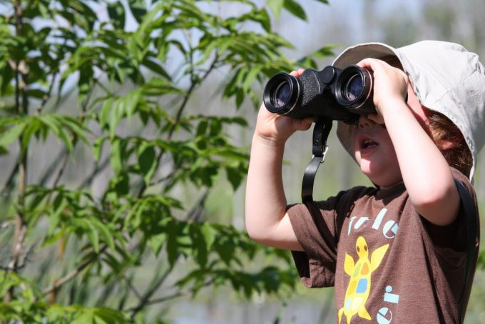 Small boy with binoculars