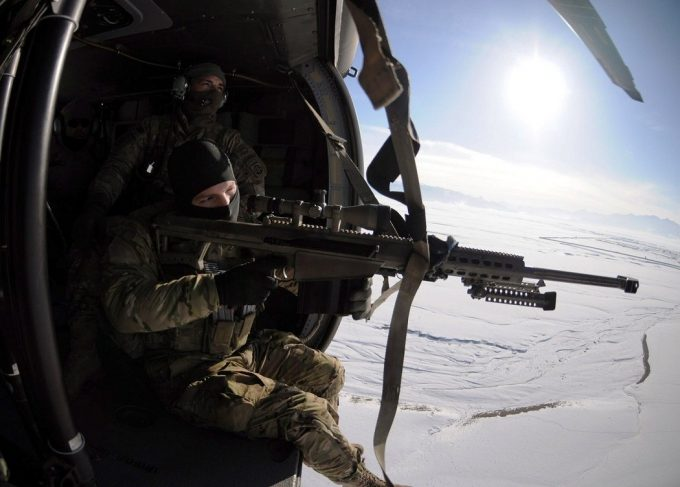 Sniper on helicopter