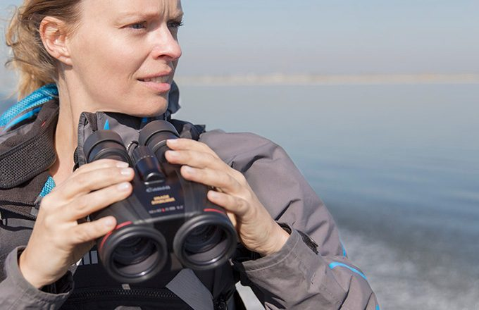 Woman using marine binoculars