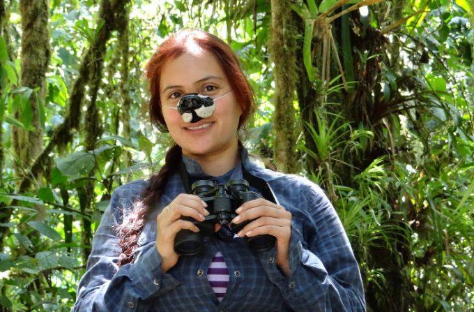 Girl using birding binoculars