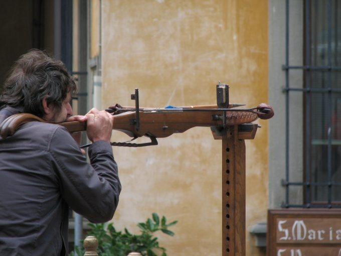 A man shooting a crossbow