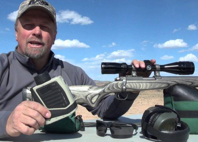 man with bushnell rangefinder