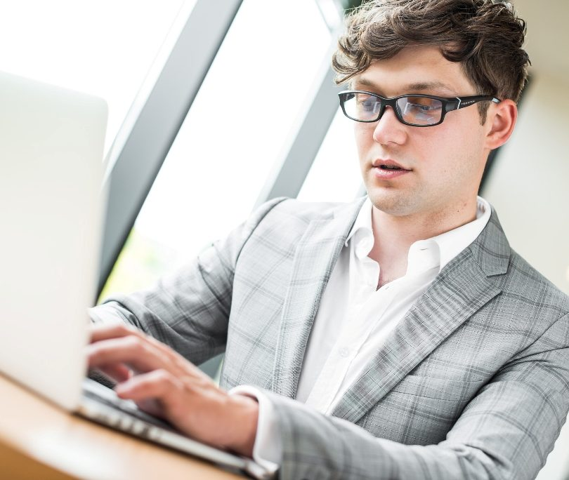Man is Working With Computer Glasses