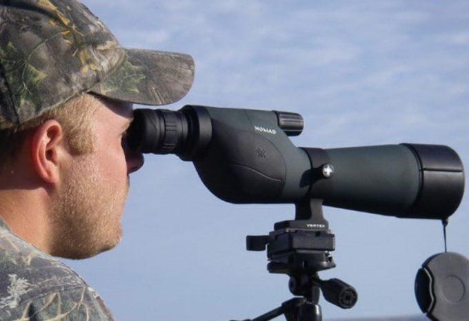 Man-using-spotting-scope
