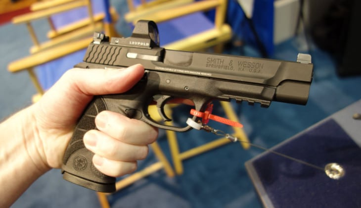 Pistol reflex sights on display