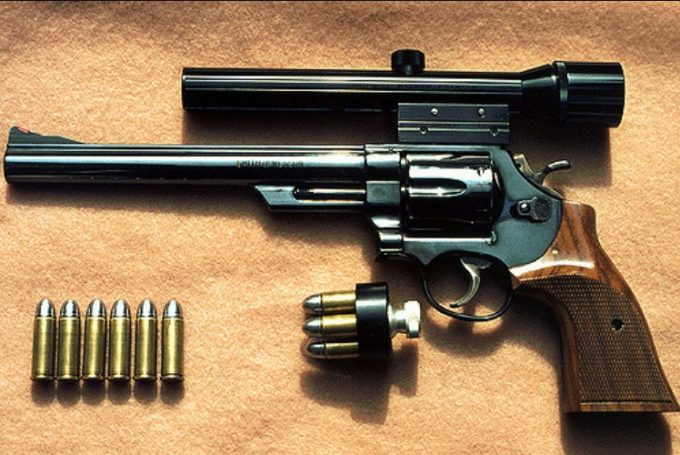 revolver with scope and bullets