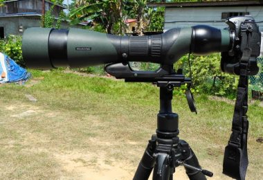 Spotting scope mounted on camera