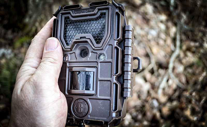 Holding a trail camera