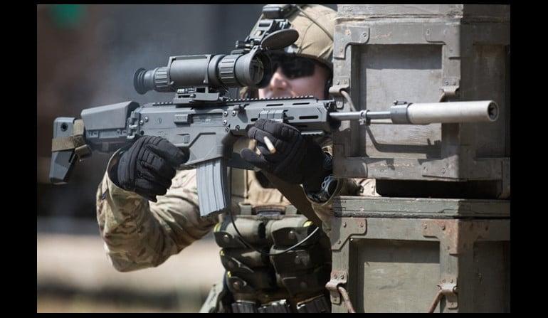 Soldier using thermal scoped gun
