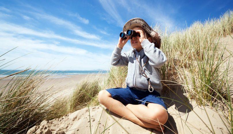 Kid using binoculars