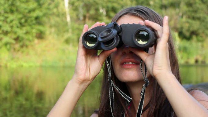 Girl using a binoculars