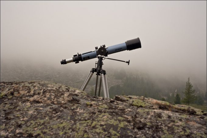 telescope on rocks