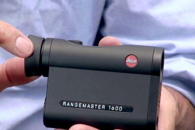 holding a leica rangefinder 1600