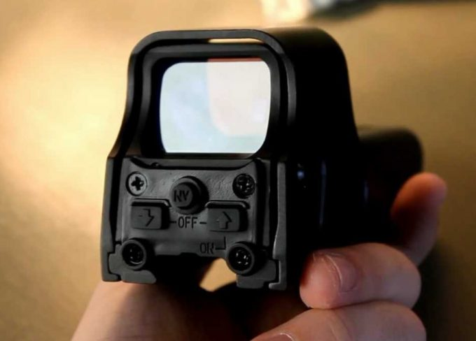 holding a red dot sight