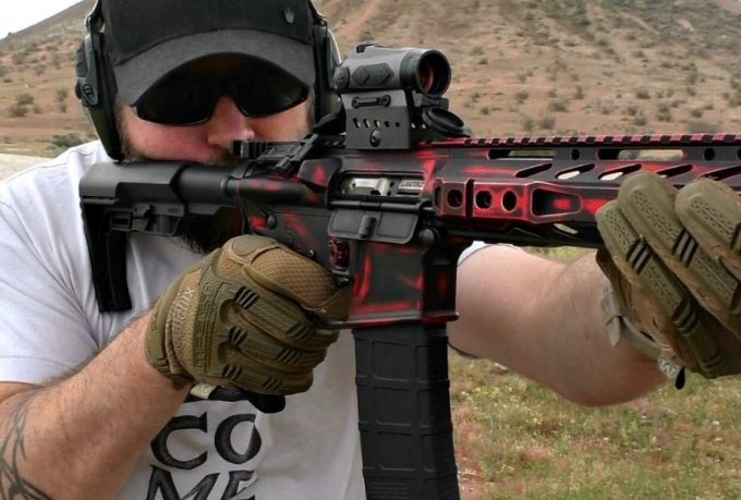 man sighting riflescope