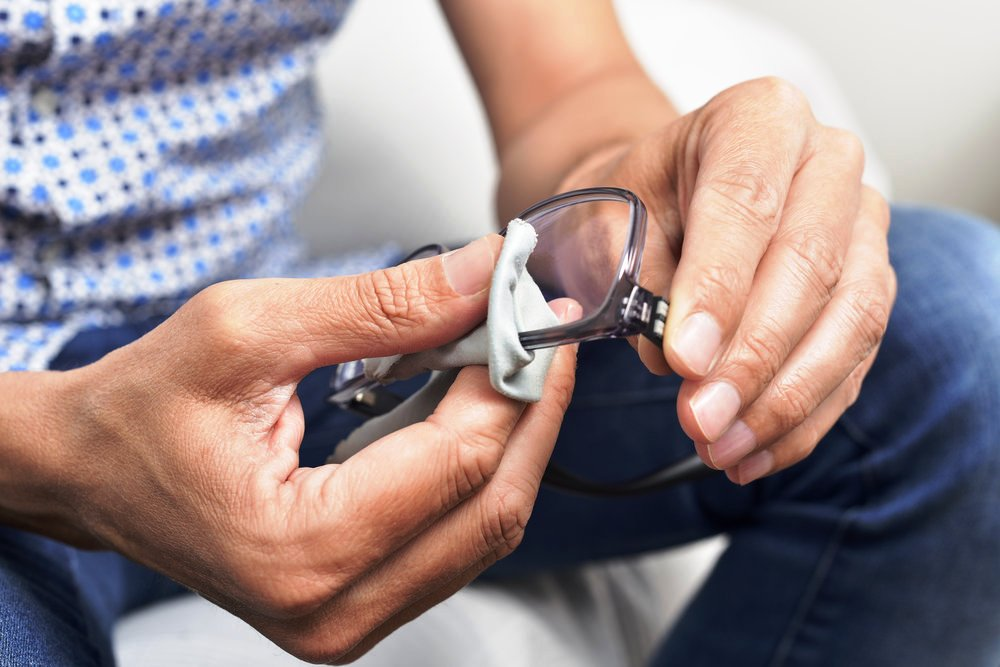 Man is Cleaning Eye Glasses